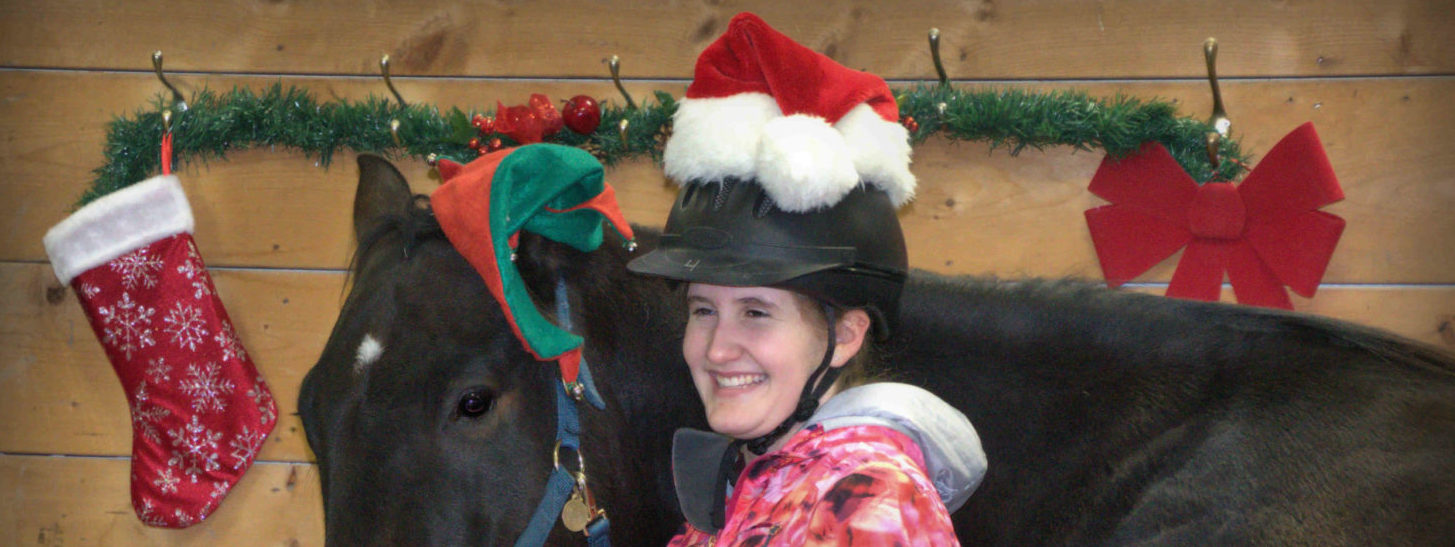 Horse and student wearing Santa hats