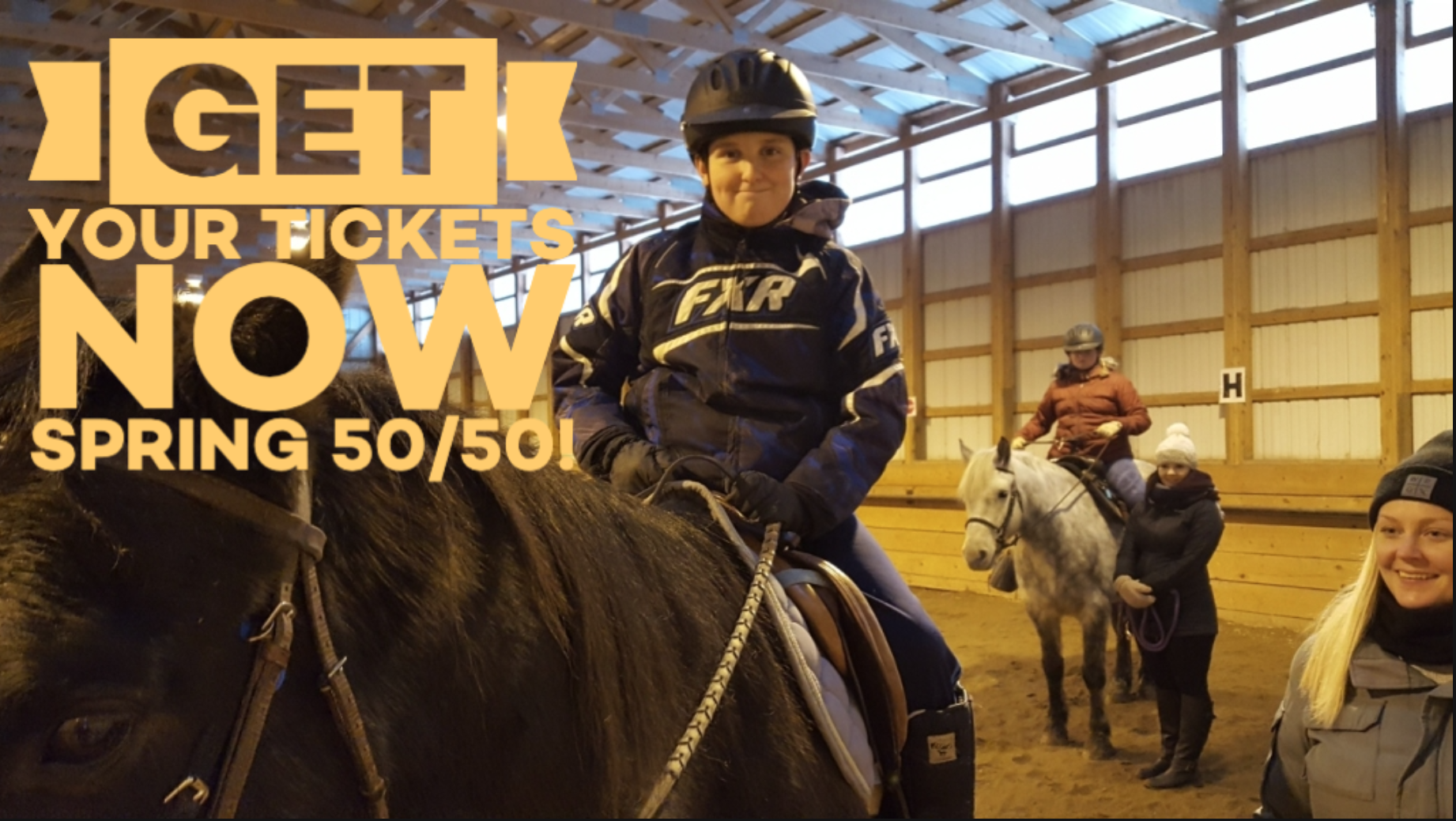 Student riding horse announcing 50/50 raffle