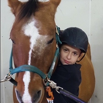 Kid hugging horse